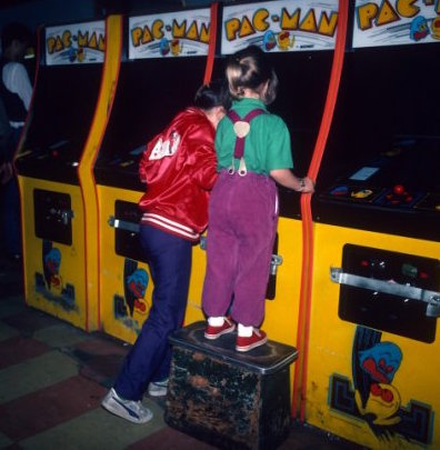 Young girls are photographed June 1, 1982 playing Pac-Man at a video arcade in Times Square, New York City. (Photo by Yvonne Hemsey/Getty Images)
